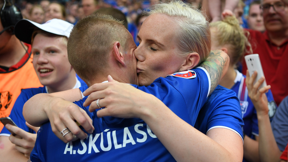 PARIS, FRANCE - JUNE 22: Ari Skulason of Iceland celebrates his team's 2-1 win with his wife after the UEFA EURO 2016 Group F match between Iceland and Austria at Stade de France on June 22, 2016 in Paris, France. (Photo by Shaun Botterill/Getty Images)