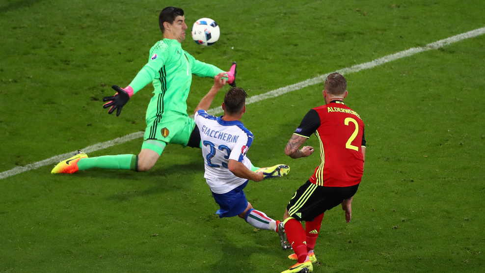 LYON, FRANCE - JUNE 13: Emanuele Giaccherini (C) of Italy scores his team's first goal past Thibaut Courtois of Belgium during the UEFA EURO 2016 Group E match between Belgium and Italy at Stade des Lumieres on June 13, 2016 in Lyon, France. (Photo by Clive Brunskill/Getty Images)