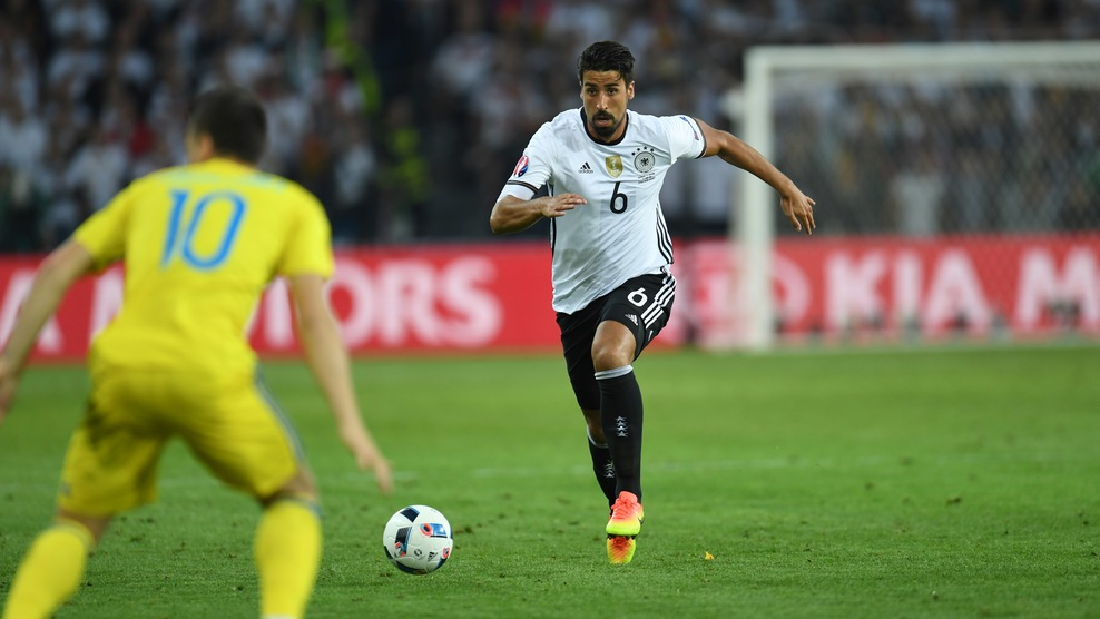 Germany's midfielder Sami Khedira (R) runs with the ball during the Euro 2016 group C football match between Germany and Ukraine at the Stade Pierre Mauroy in Villeneuve-d'Ascq near Lille on June 12, 2016. / AFP / PATRIK STOLLARZ (Photo credit should read PATRIK STOLLARZ/AFP/Getty Images)