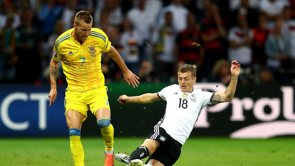LILLE, FRANCE - JUNE 12: Andriy Yarmolenko of Ukraine and Toni Kroos of Germany compete for the ball during the UEFA EURO 2016 Group C match between Germany and Ukraine at Stade Pierre-Mauroy on June 12, 2016 in Lille, France. (Photo by Clive Mason/Getty Images)